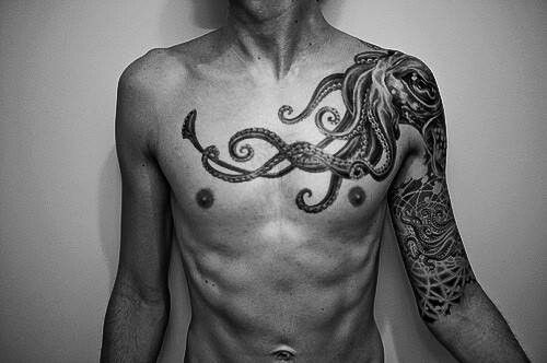 Photo of Octopus chest and sleeve tattoo                                                 …