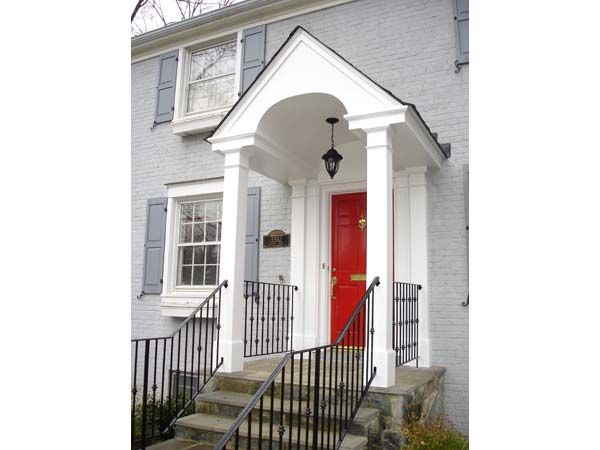 Nice Arched Portico With Squared Columns And Iron Railings