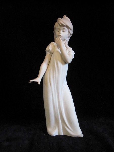 Vintage Nao porcelain by Lladro figurine of girl yawning in the rare matte finish.  Lladro