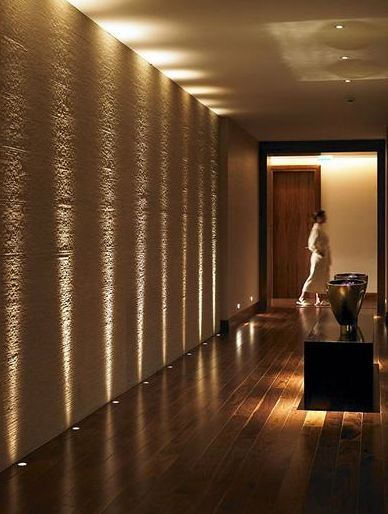 Create your own spa feel with this directional lighting that enhances the natural texture of walls also long corridor design ideas perfect for hotels and public spaces rh pinterest