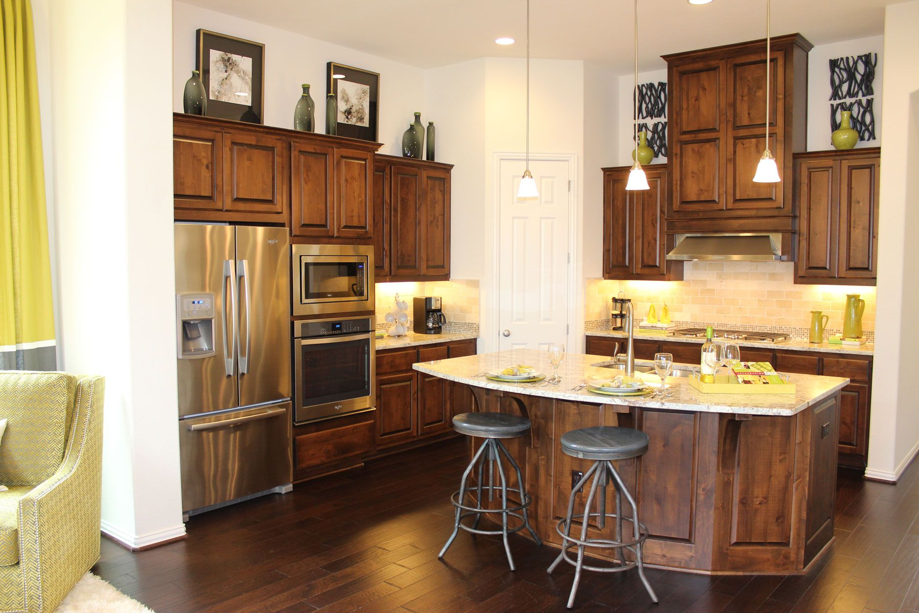 Model Home With Knotty Alder Cabinet Doors Large Island And Dark Wood Floors Lime Green