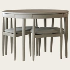 Round table with four chairs (three legs). Would b nice to save room ...