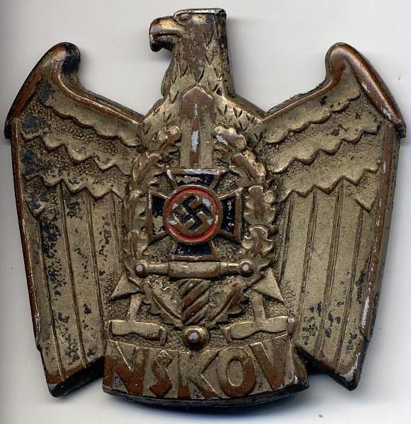 A German World War Two, Old Comrades Badge showing an eagle perched on a plaque with the letters NSKOV. Order Now: http://www.thirdreichmedals.com/