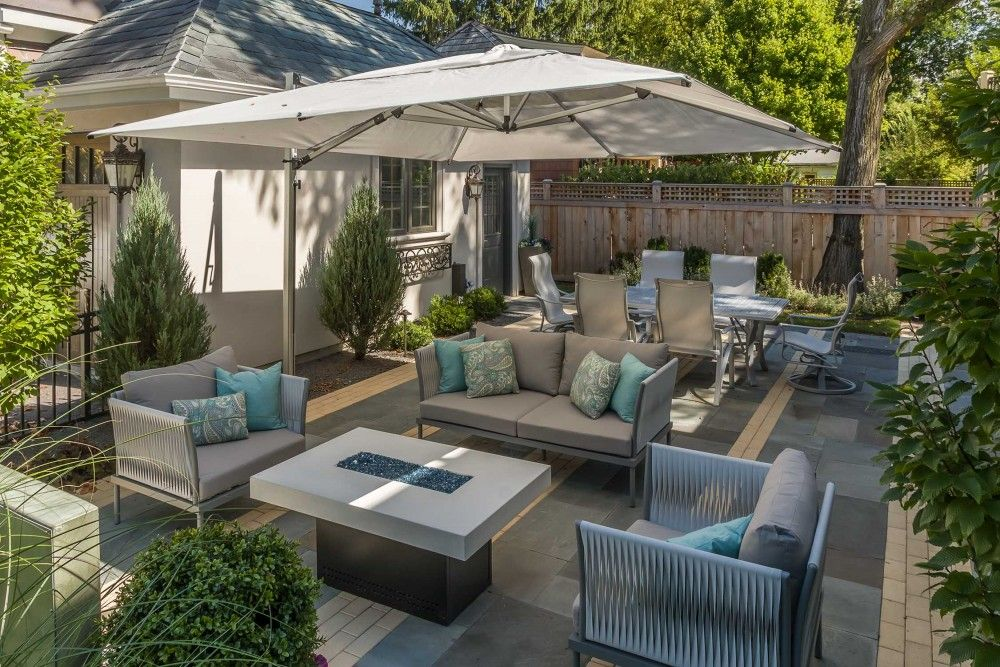 Oversized Shade Umbrella Makes The Patio Comfortable On Sunny Days French Provincial With A City Twist By Chicago Speci Backyard Patio Patio Patio Umbrellas