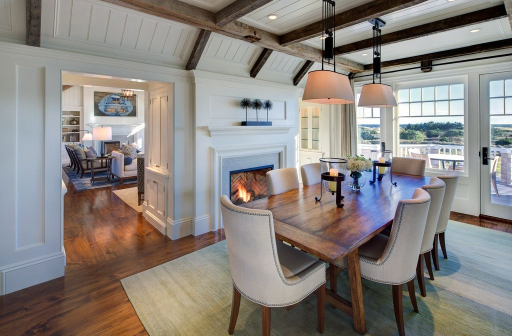Cottage Dining Room With Exposed Beam Metal Fireplace Hardwood Floors Kichler Donington 3 Light Drum Pendant Carpet