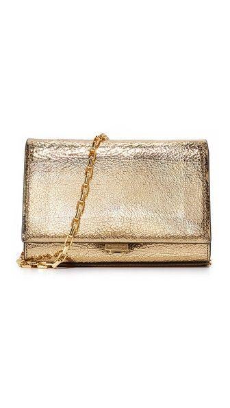 2f58ef702f9 ¡Consigue este tipo de bolso de mano de Michael Kors Collection ahora! Haz  clic