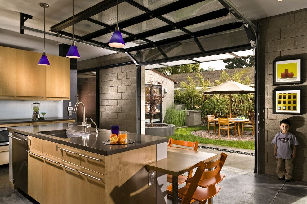 Kitchen With Private Courtyard Outside Glass Garage Doors Modern