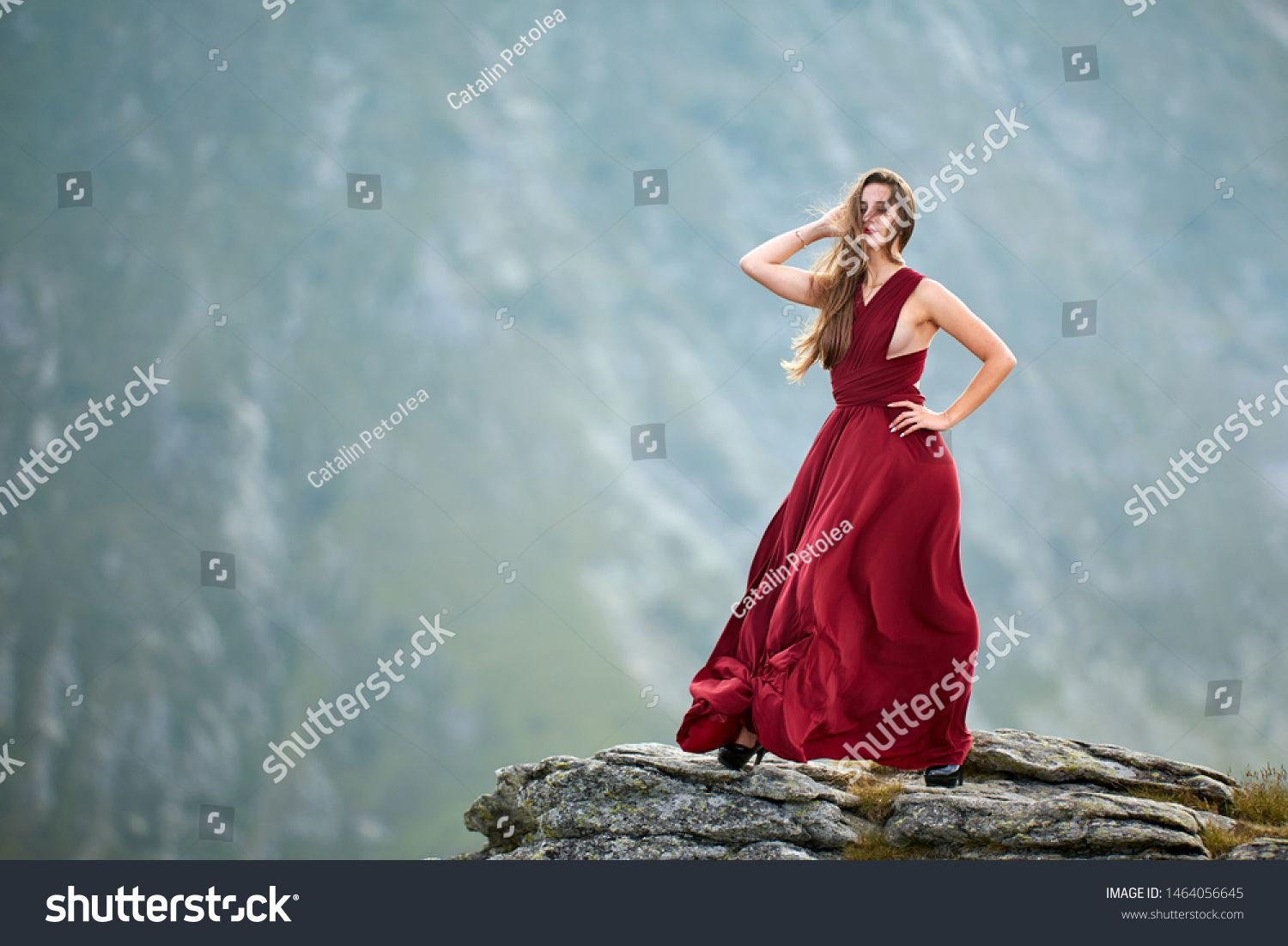 Beautiful female fashion model in red dress on mountain rocks #Sponsored , #spon, #fashion#model#Beautiful#female