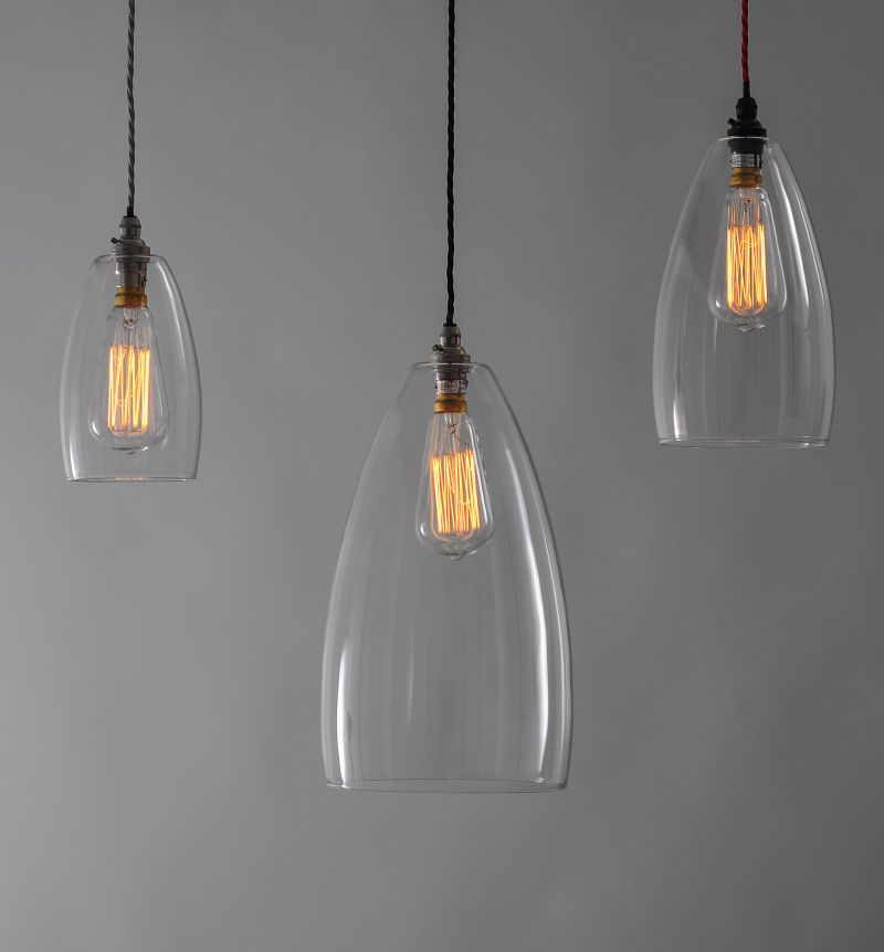 A cluster of Upton clear glass pendant lights with squirrel cage
