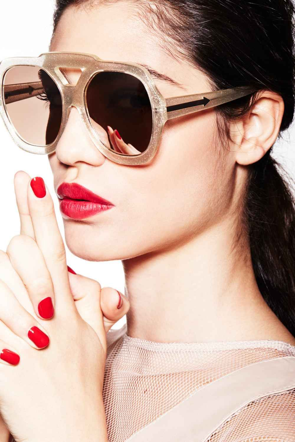 """Electro-Red Red-hot lips and matching nails smolder in the summer sun. It's enough of a statement that you can keep the rest of your outfit in the nude-color family. That goes for your makeup, too, especially during the day. """"Red is a minimalist's best friend,"""" Hubbard says. """"A tinted moisturizer, mascara, and a defined brow are all you need to go with it."""" As for how to pick the perfect red? """"If you have a cool complexion, go for a blue-based red. If you're warm-toned, an orange or coral…"""