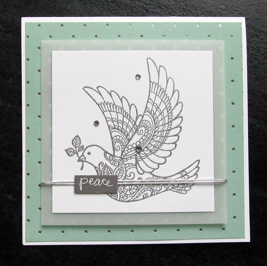 """November 2015. Friday Card. """"Dove of Peace"""". Friday Sisters will make (4) embossed cards of this design (2 each of 2 different backgrounds), with the option of coloring the dove with blender pens and inks.  The next pin shows the second background with the coloring option. See inspiration on my CASE'd board."""
