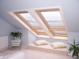 Skillion roof over garage: put bed at low point and sky lights above.