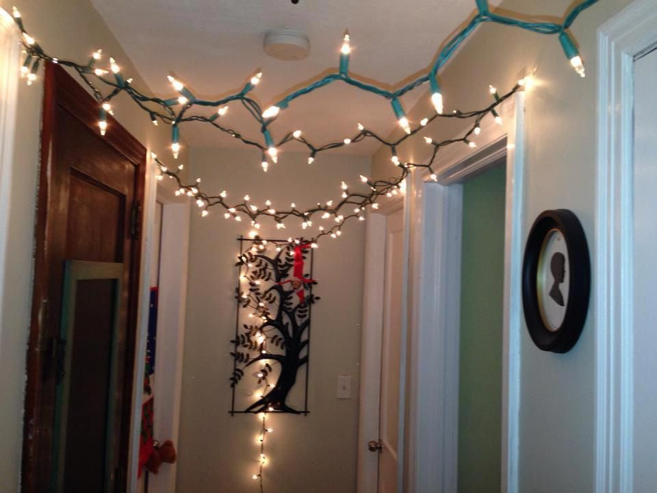 Elf on the shelf hanging lights from the ceiling! Circus sol Elf
