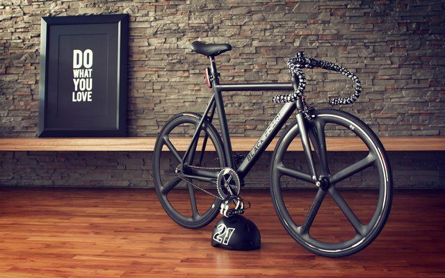 """Black fixie bike, cool wall and """"Do what you love"""" poster."""