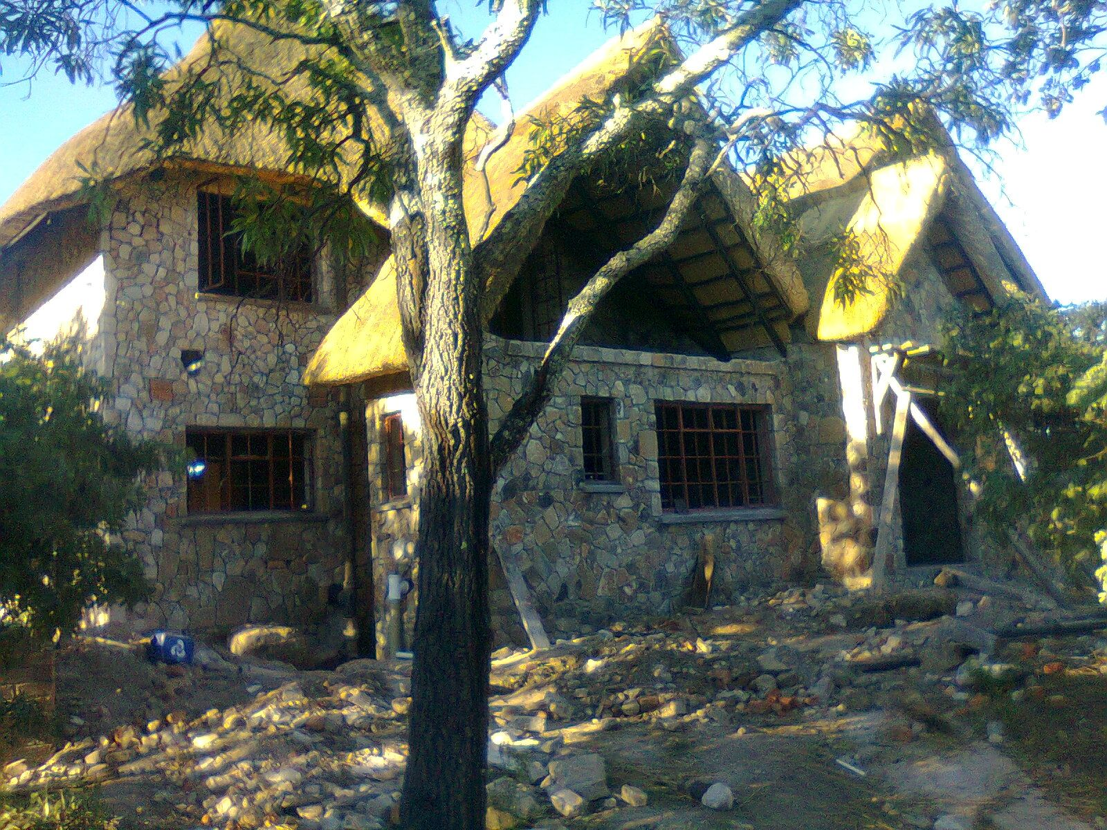 Nyanga zimbabwe stone under thatch thatched house peaceful home zimbabwe cottage ideas
