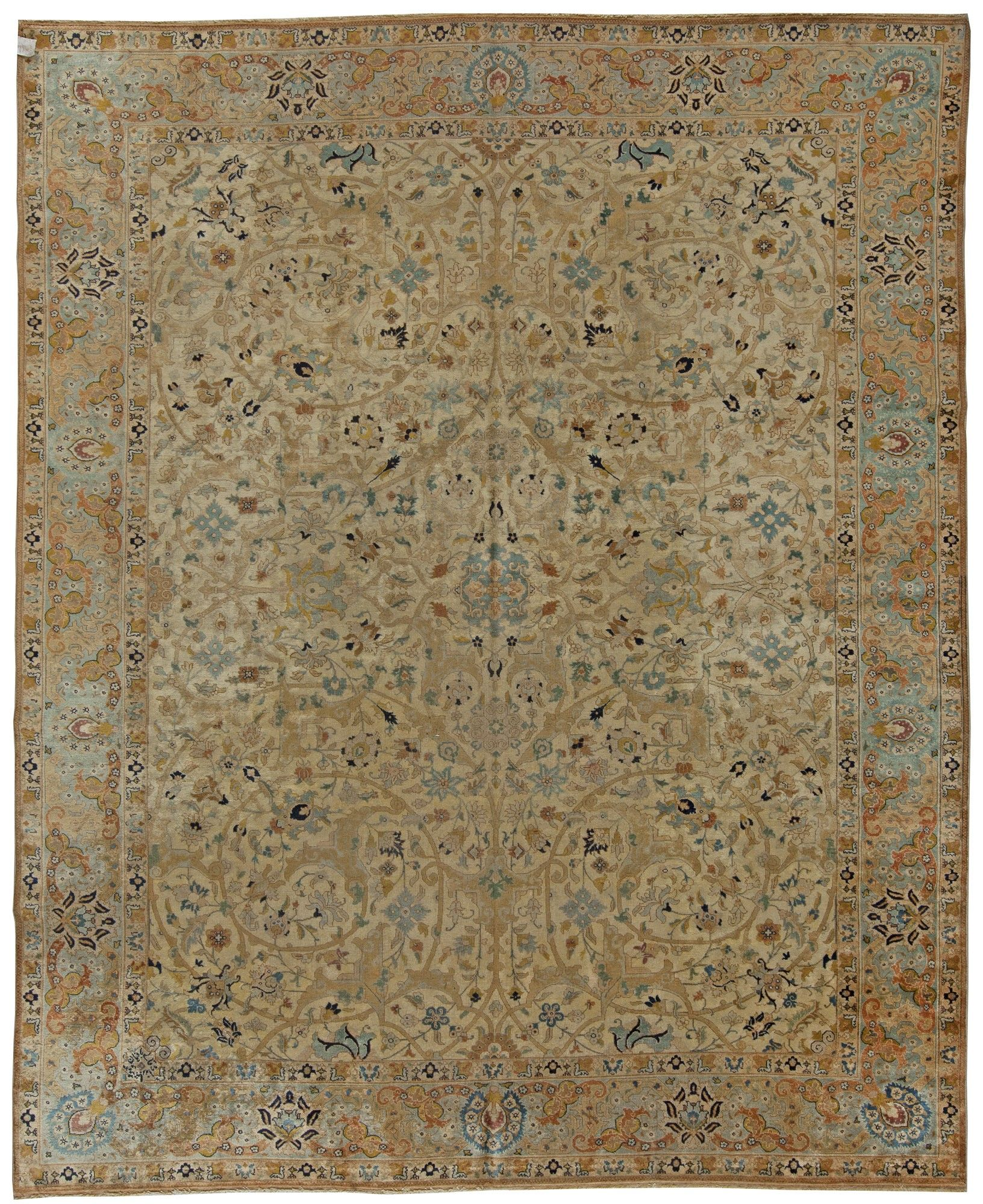 An early 20th century Persian Tabriz antique rug, the cream field with an…