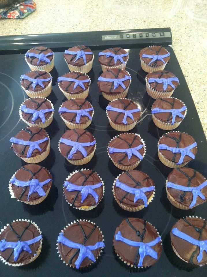 Karate Gi with purple belt cupcakes. Easy to make and perfect for a belt promotion. I made these and decorated in 3 hours, right before the party started.