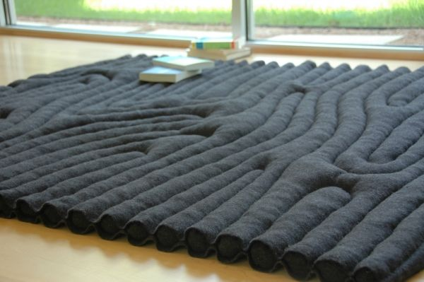 PLAY ROOM: Found this wool at http://www.armysurplusworld.com/product.asp?ProductID=10122. for 28.99 for 5x7. Just need to insulate and sew.Made of 100% wool Russian army blankets