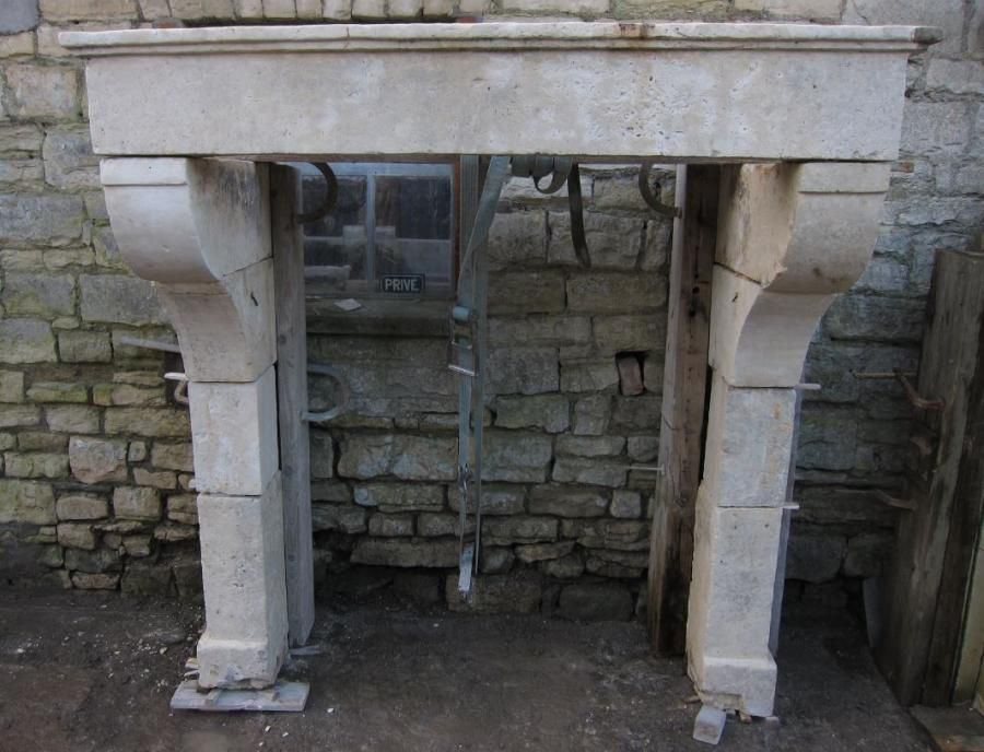 Large Louis XIII limestone fireplace circa 1680 from the Charente region of France. Very good original condition, currently undergoing sympathetic restoration. For sale on SalvoWEB from Wharton Antiques in Somerset [Salvo code dealer