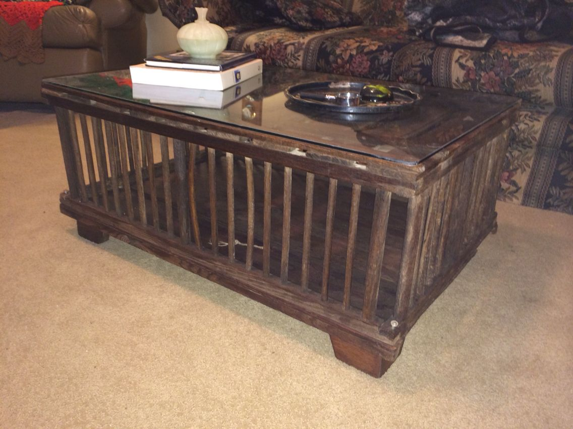 Old chicken coop cage made into Coffee table Put legs and glass top