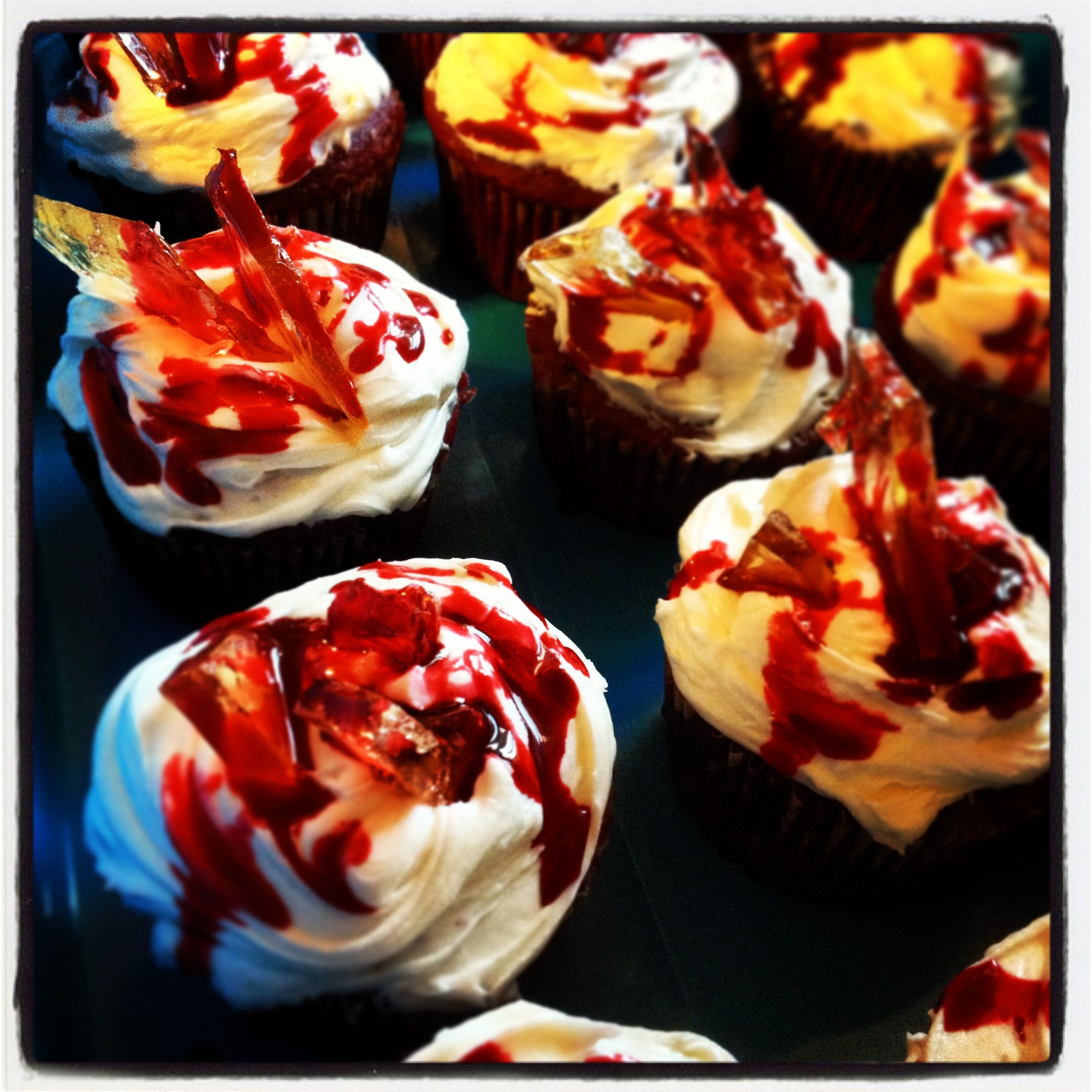 Happy Bloody Dexter Birthday! Red velvet cupcakes with marshmallow frosting, decorated with sugar glass, and corn syrup/cornstarch blood.