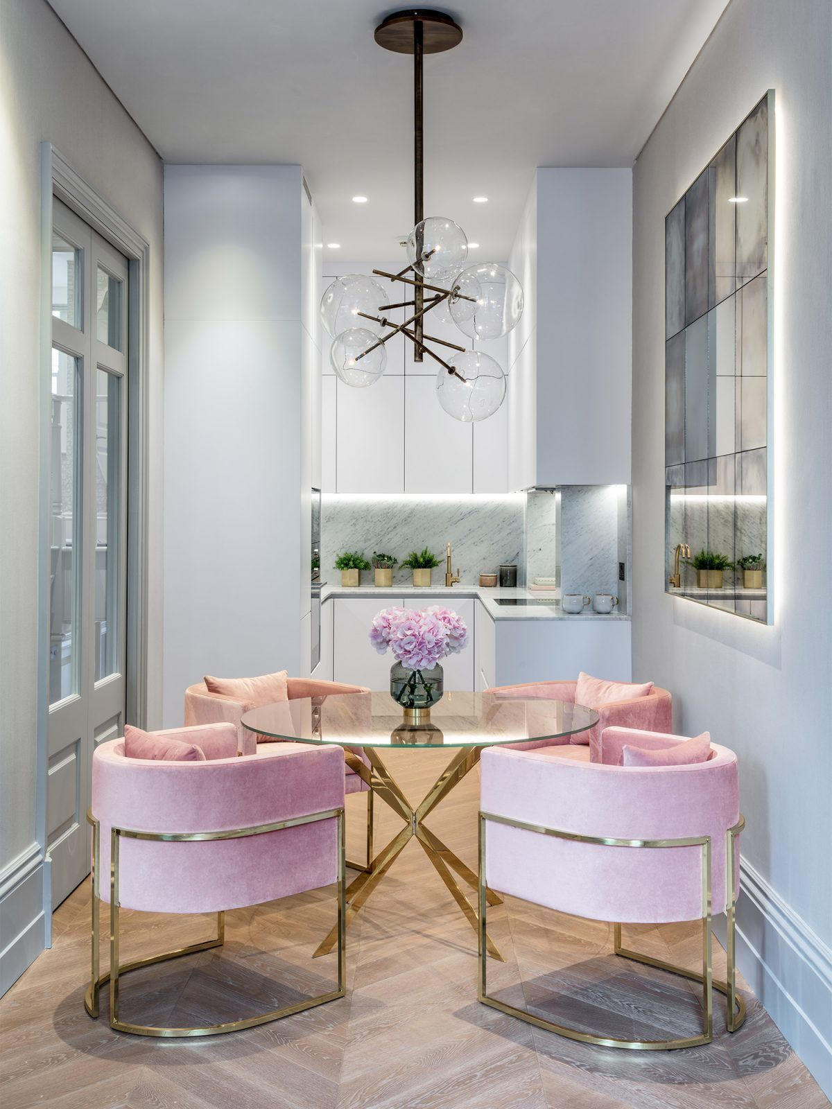32 Stylish Dining Room Ideas To Impress Your Dinner Guests: Pink Velvet Chairs In Small London Apartment With Marble