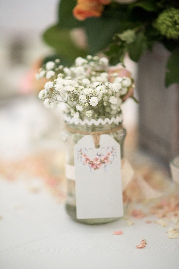 Baby's breath in Mason jar decorated wedding reception table