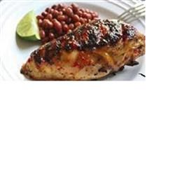 Chicken is soaked in a flavorful brine with hot peppers and tomatoes before being grilled until crispy on the outside and moist and juicy on the inside.