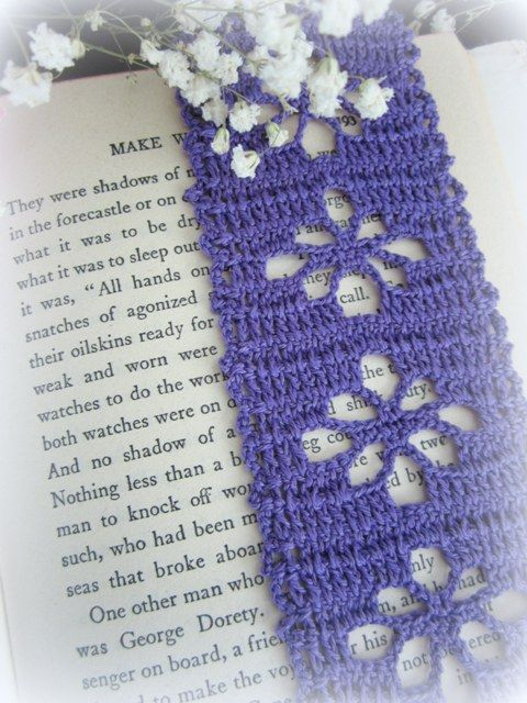 In filet crochet bookmark with flowers.