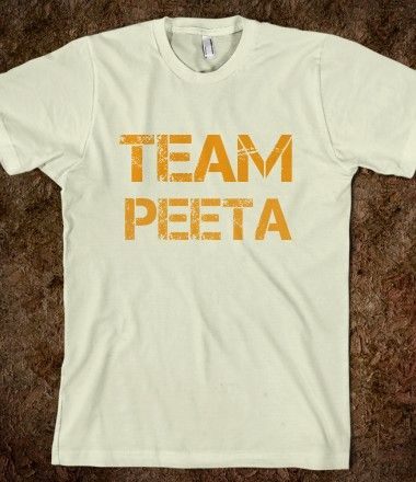 Has a flame and mocking jay on back. NEED THIS!