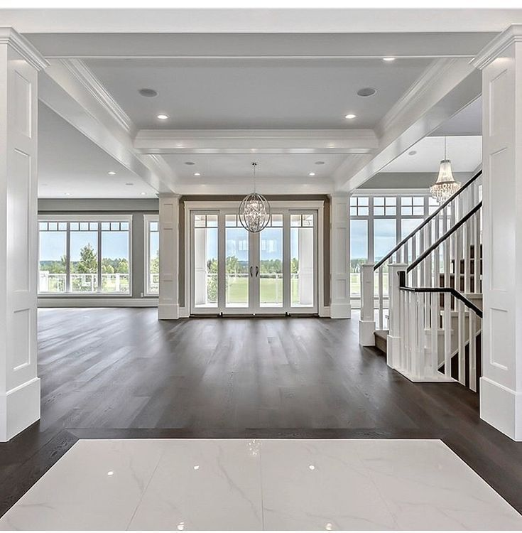 White living room with floor to ceiling windows french doors coffered ceiling White living room with floor to ceiling windows french doors coffered ceiling molding mouldi...