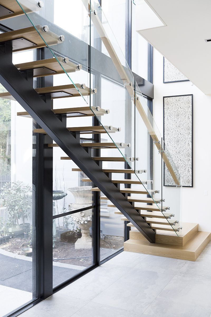 Stairs contemporary staircase architecture american oak glass balustrade timber treads for Home designer stairs with landing