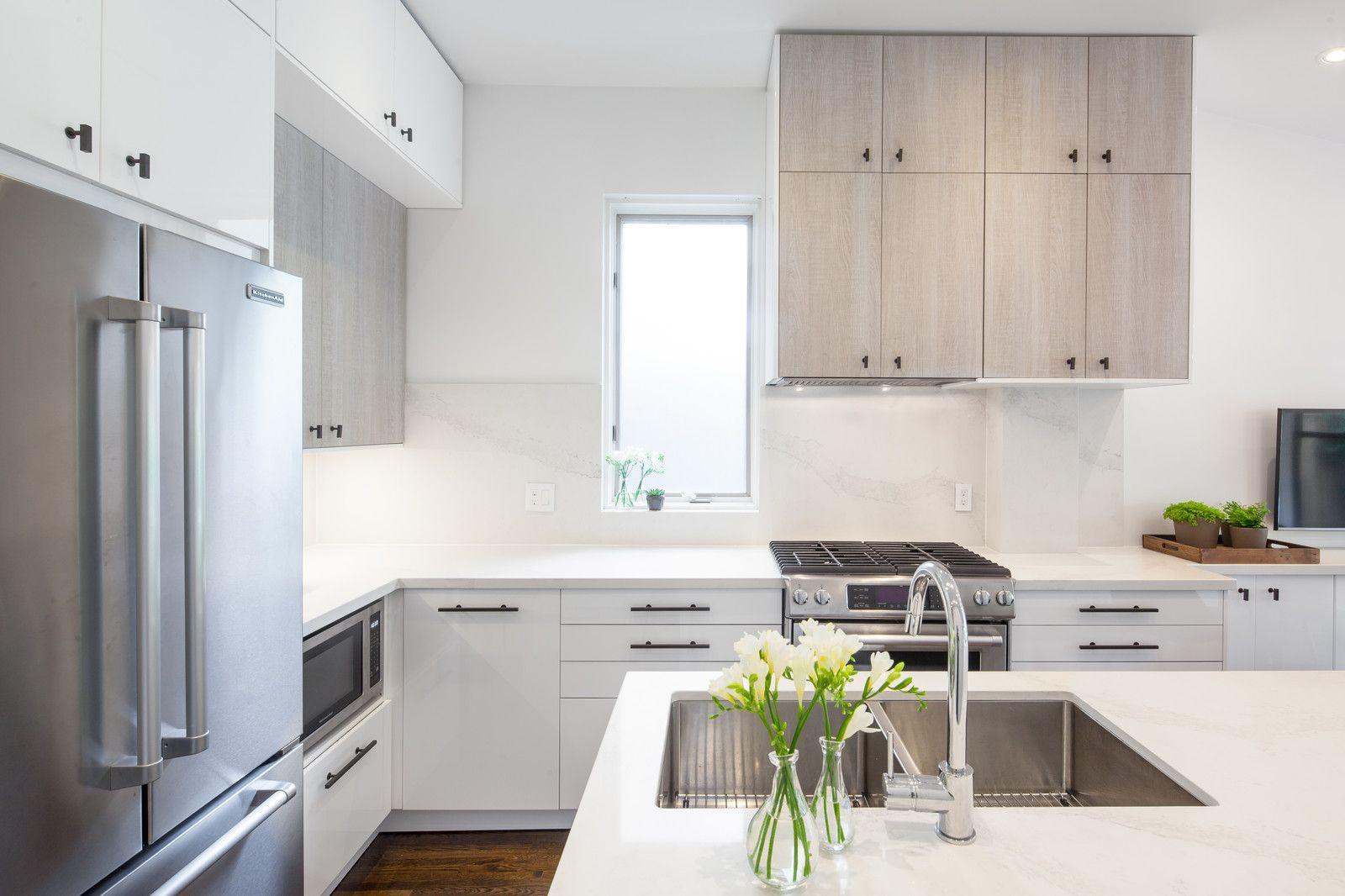 Eatin kitchen midsized modern lshaped medium tone wood floor