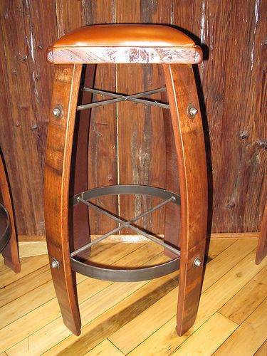 Bar stools made from old whiskey barrels there 39 s no for Diy whiskey barrel bar