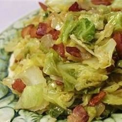 Fried cabbage with bacon, onion and garlic