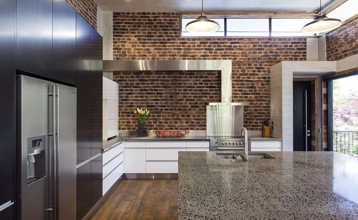 Brick, stainless steel, wood in harmony