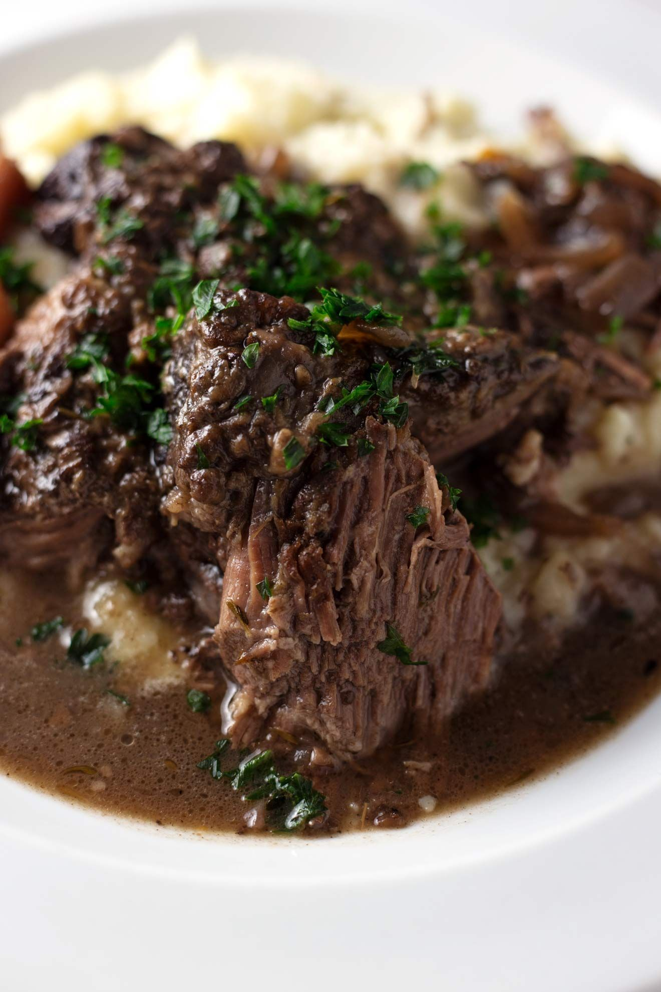 One Pot Red Wine Braised Beef Roast with Carrots, Onions, and Garlic -