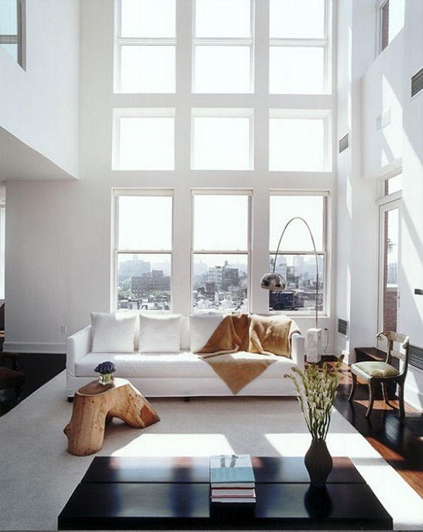 Living room in a Greenwich Village townhouse and the living room of a Soho penthouse – both designed by Kelly Behun.