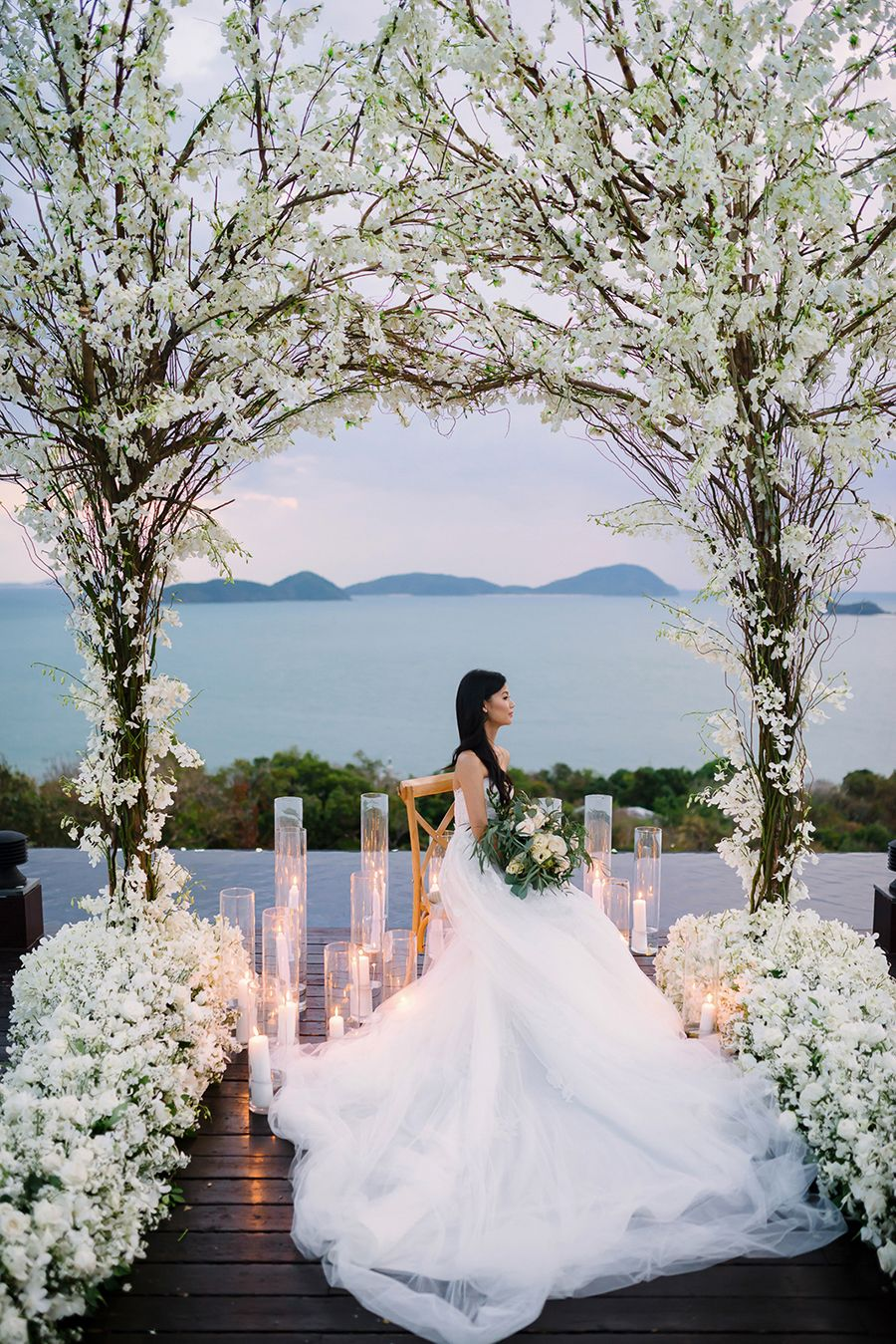 white and blush wedding at sri panwa phuket and bibi
