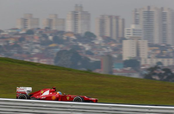 Fernando Alonso of Spain and Ferrari drives during qualifying