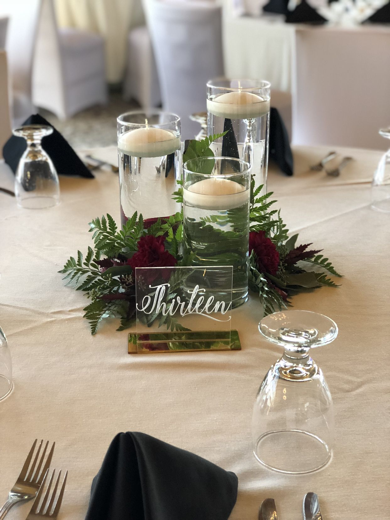 Floating Candle Centerpiece With Hand Places Fern And Eucalyp
