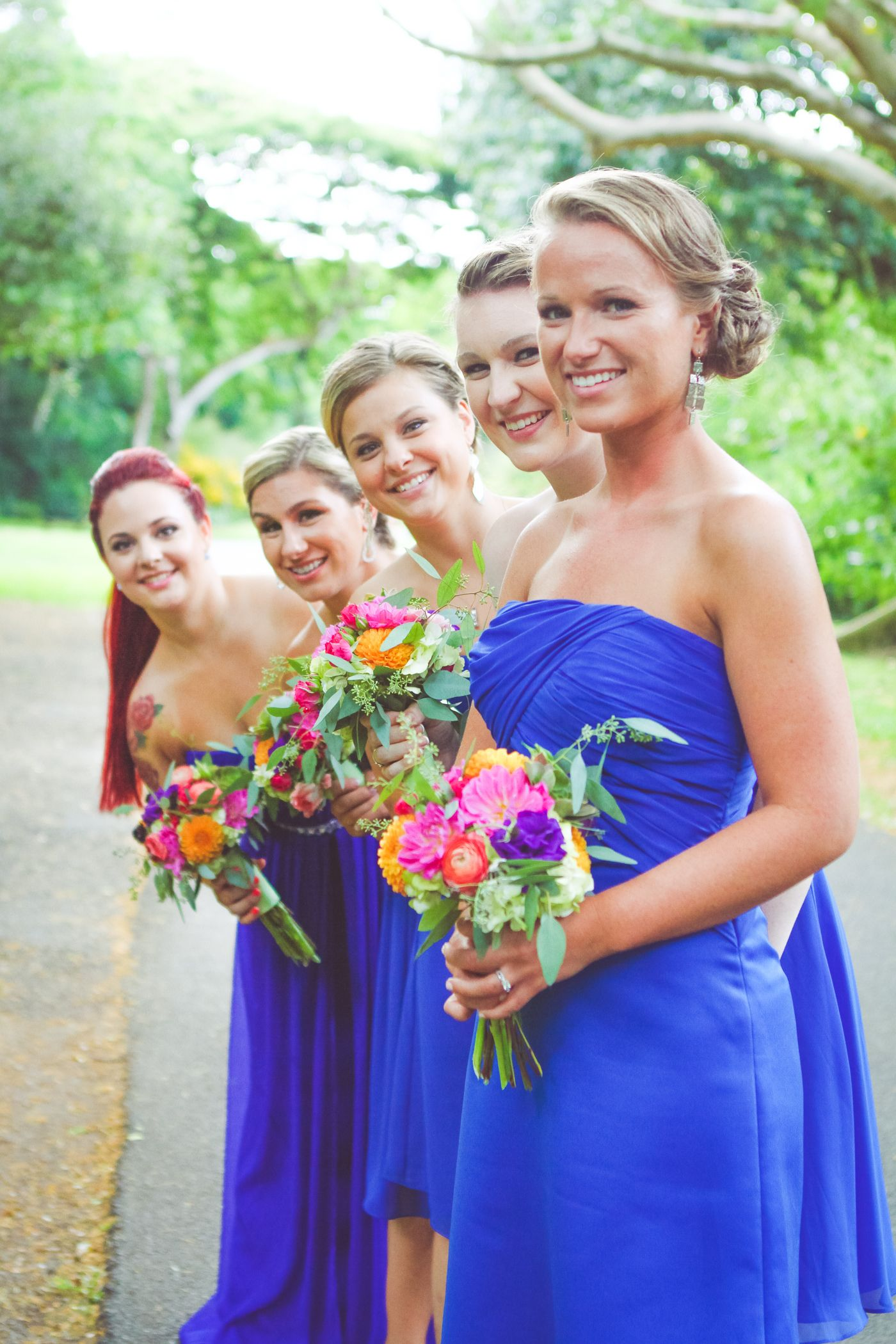 Bright blue strapless bridesmaid dresses and colorful tropical bright blue strapless bridesmaid dresses and colorful tropical bouquets ombrellifo Gallery
