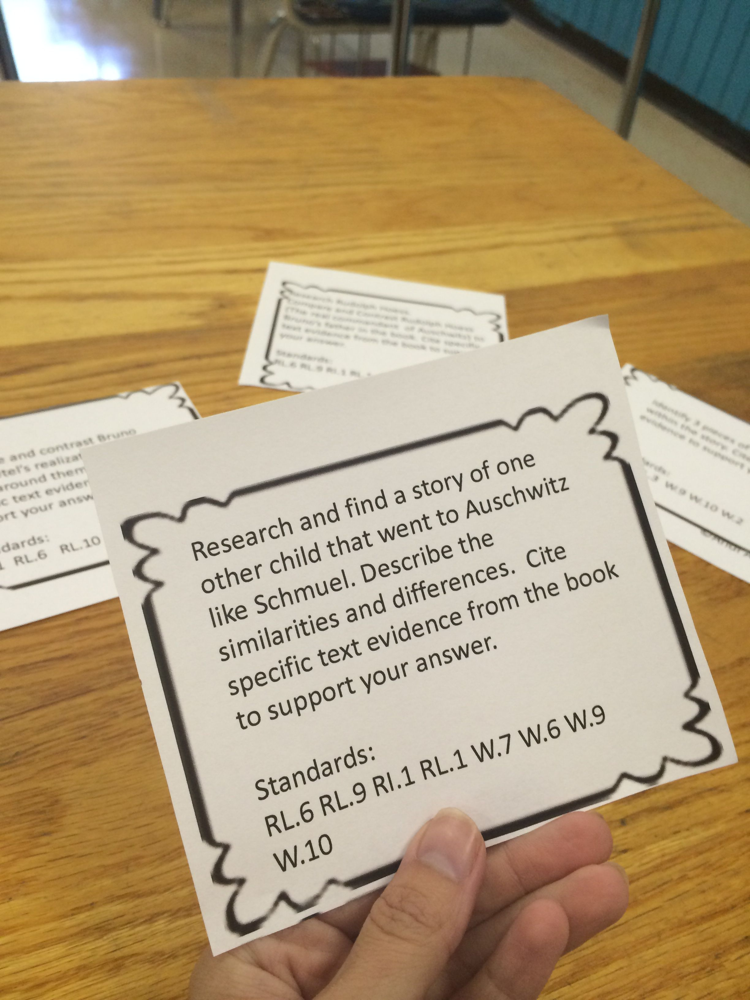 Boy in the striped pajamas writing task cards task cards