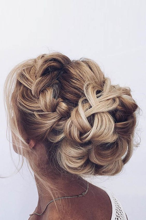 Dramatic braids like these puts your hair front and center with a super stylish look. This crown braid topped off by the braided bun speak of elegance and class.  If you want to do an extra special something with your locks try TerrificTresses.com for some mane inspiration.