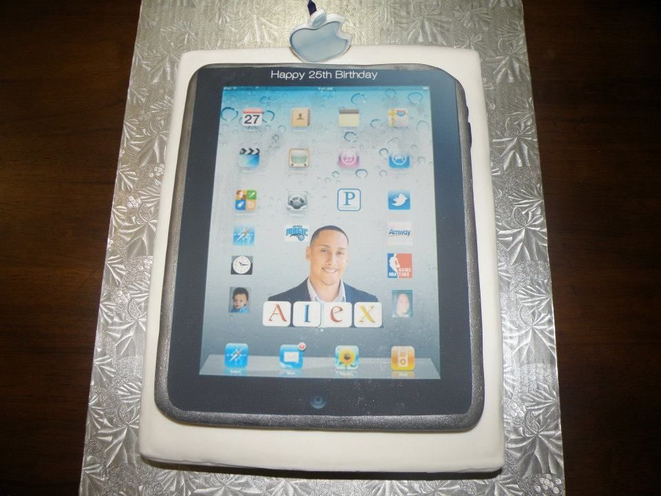 iPad cake I made for my son's 25th birthday. The box is made of yellow cake with chocolate ganache. The iPad is made out of a sugar cookie and covered in fondant.