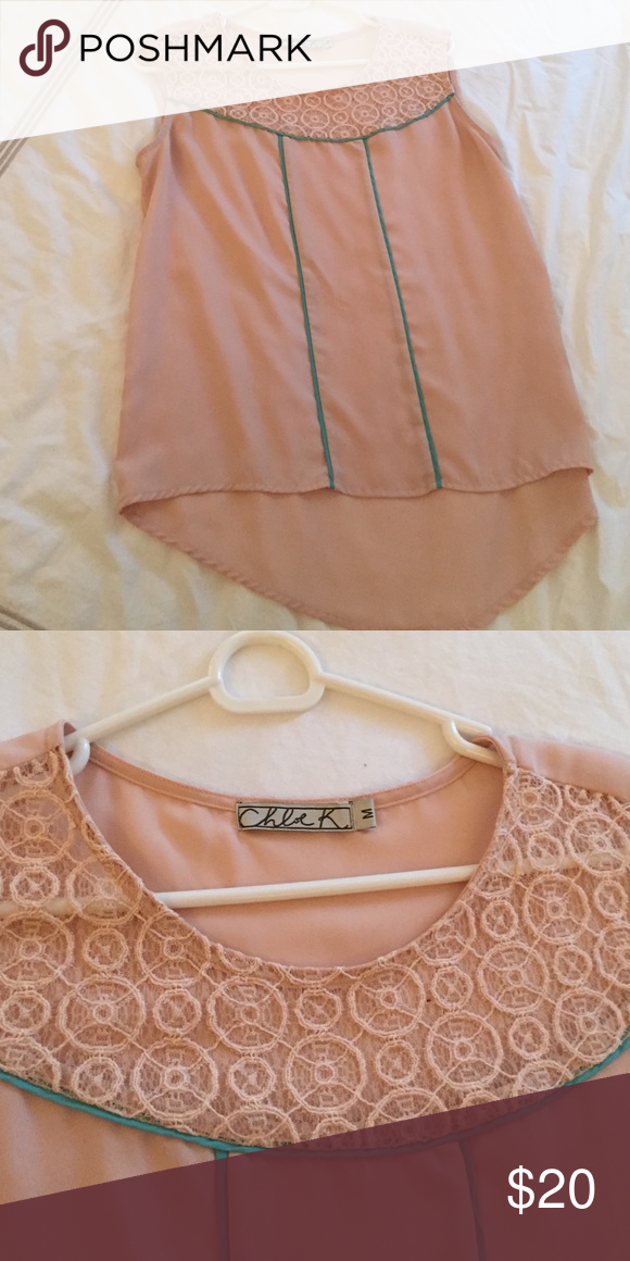 Silky high low blouse Lovely peach color with teal piping. Dress up or wear with skinny jeans and cream pumps. Chloe K Tops Blouses