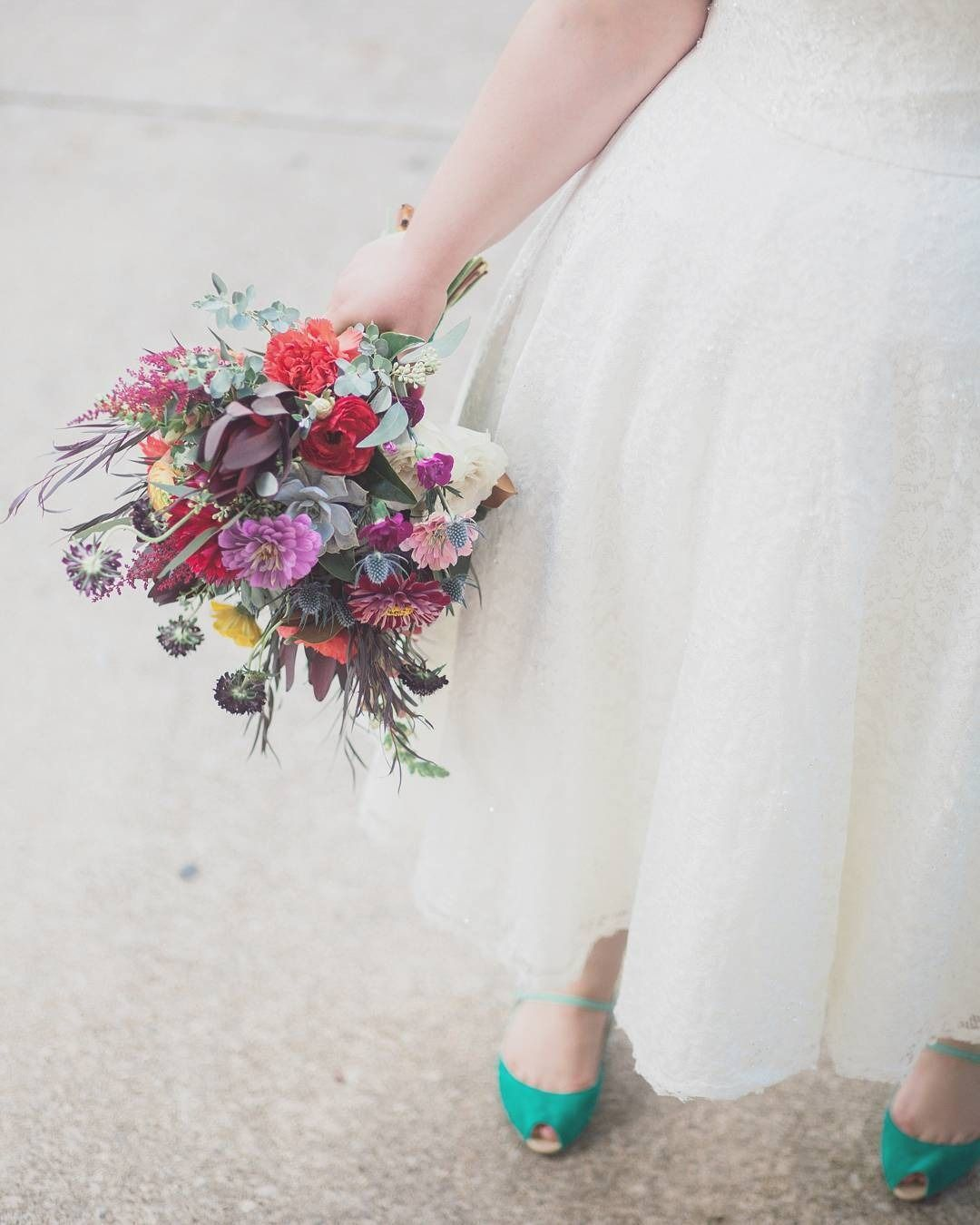 b3f1dedb741 Tea-Length Plus Size Wedding Dress with Shrug with wildflowers and a pop of  green! Photo by Krista Turner