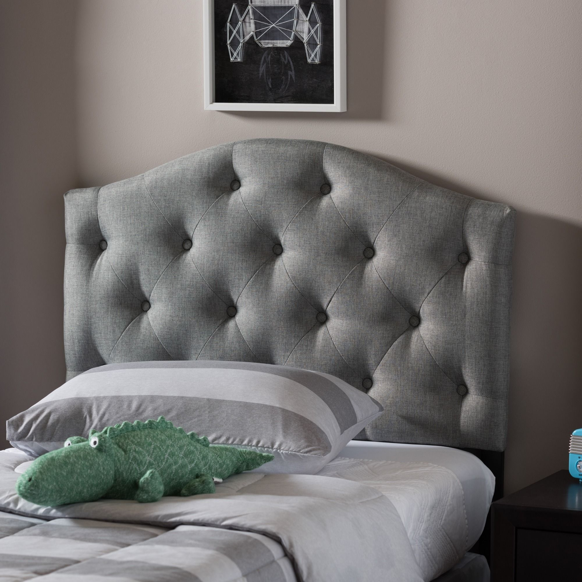 The durable headboard is made of rubberwood and is filled with foam ...