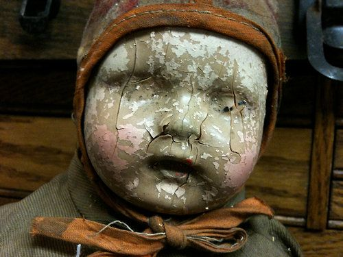 A very well-loved doll! A face with the features kissed away!