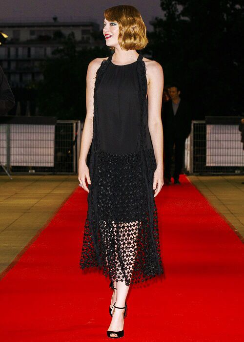 Emma Stone attends Magic in the Moonlight premiere in Paris.